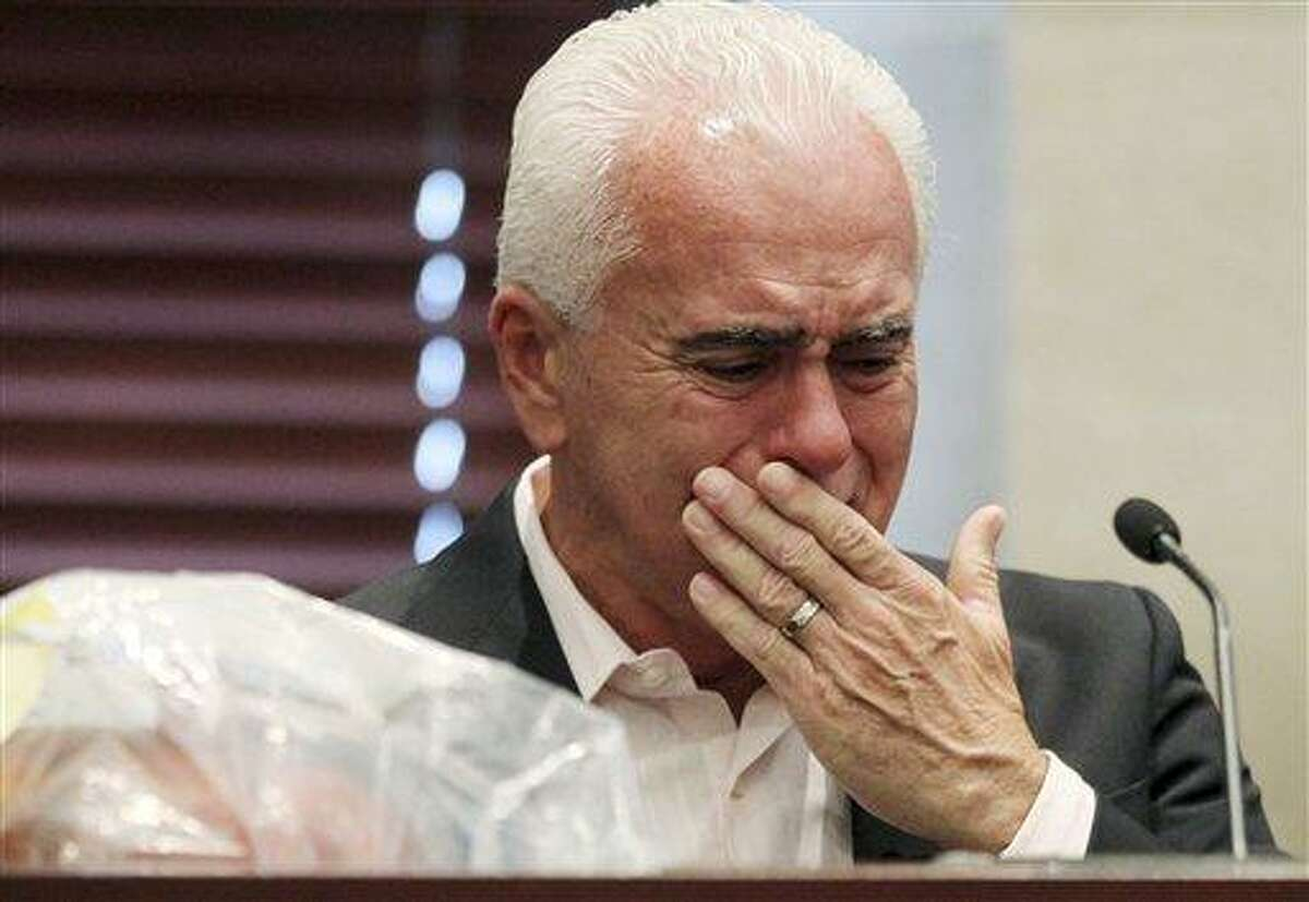 George Anthony reacts during his testimony in the murder trial of his daughter, Casey, in Orlando, Fla., Wednesday, June 29, 2011. Casey Anthony has plead not guilty to first-degree murder in the death of her daughter, Caylee, and could face the death penalty if convicted of that charge. (AP Photo/Red Huber, Pool)