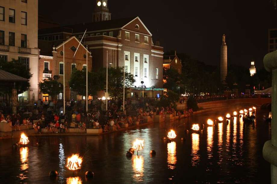 Go Providence photo: WaterFire brings out the tourists and locals alike. The river spectacle will be held seven times, Saturday through October.