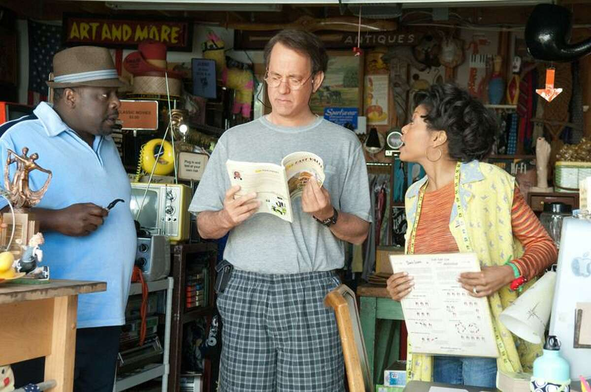 """Bruce Talamon/Universal Pictures: Cedric the Entertainer and Taraji P. Henson run a perpetual garage sale in Tom Hanks' """"Larry Crowne."""""""