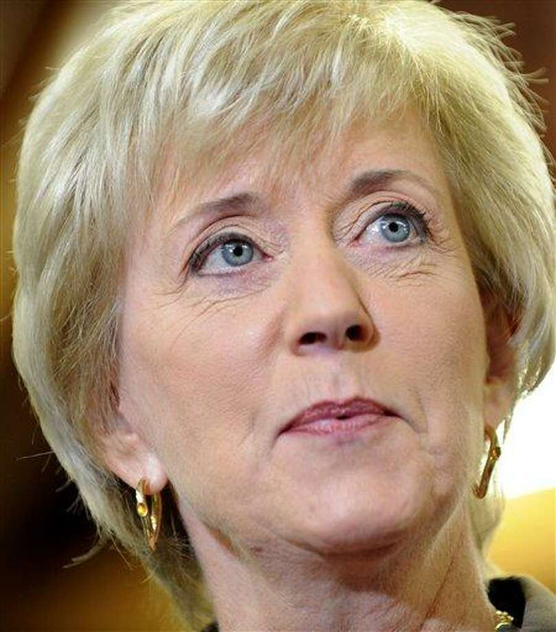FILE - In this Sept. 20, 2011 file photo, former World Wrestling Entertainment chief executive Linda McMahon announces her plans to seek for a second time the Republican endorsement for Connecticut's U.S. Senate seat in Southington, Conn.  (AP Photo/Jessica Hill, File) Photo: AP / AP2011
