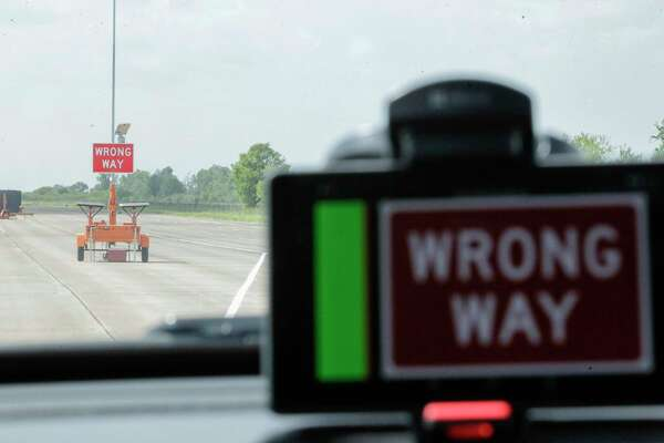 An in-car device flashes an alert that it is entering a ramp the wrong way Wednesday during a demonstration of an ongoing research project by the Texas A&M Transportation Institute and Southwest Research Institute.
