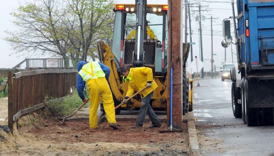 Repairs to the beach area in West Haven across from Chick's Drive-in includes sidewalk repair. Colonna Concrete and Asphalt (West Haven) workers Miguel Rodriguez, left, and Miguel Sandoval at work.  Mara Lavitt/New Haven Register