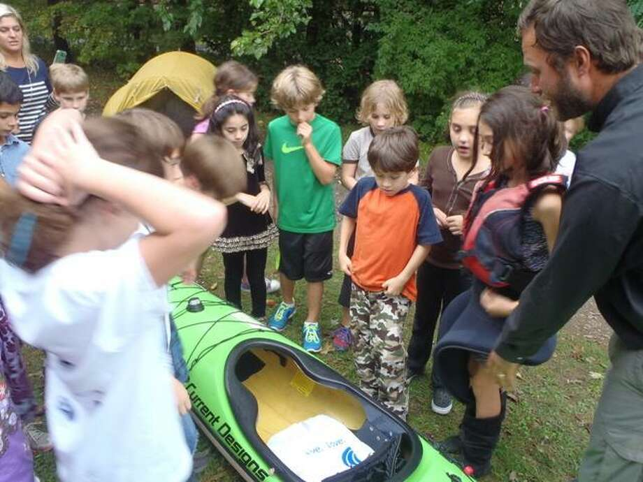 Foote School third-graders learn about the kayaks used by the Freemans.