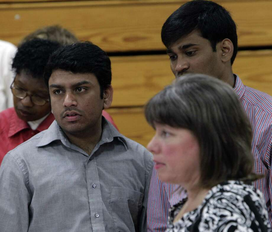 In this June 15 photo, Rakesh Dodda, second from left, stands in a line at a job fair in Southfield, Mich.  A private research group is reporting that consumers' confidence declined to a seven-month low as job worries increased. (AP Photo/Paul Sancya) Photo: ASSOCIATED PRESS / AP2011