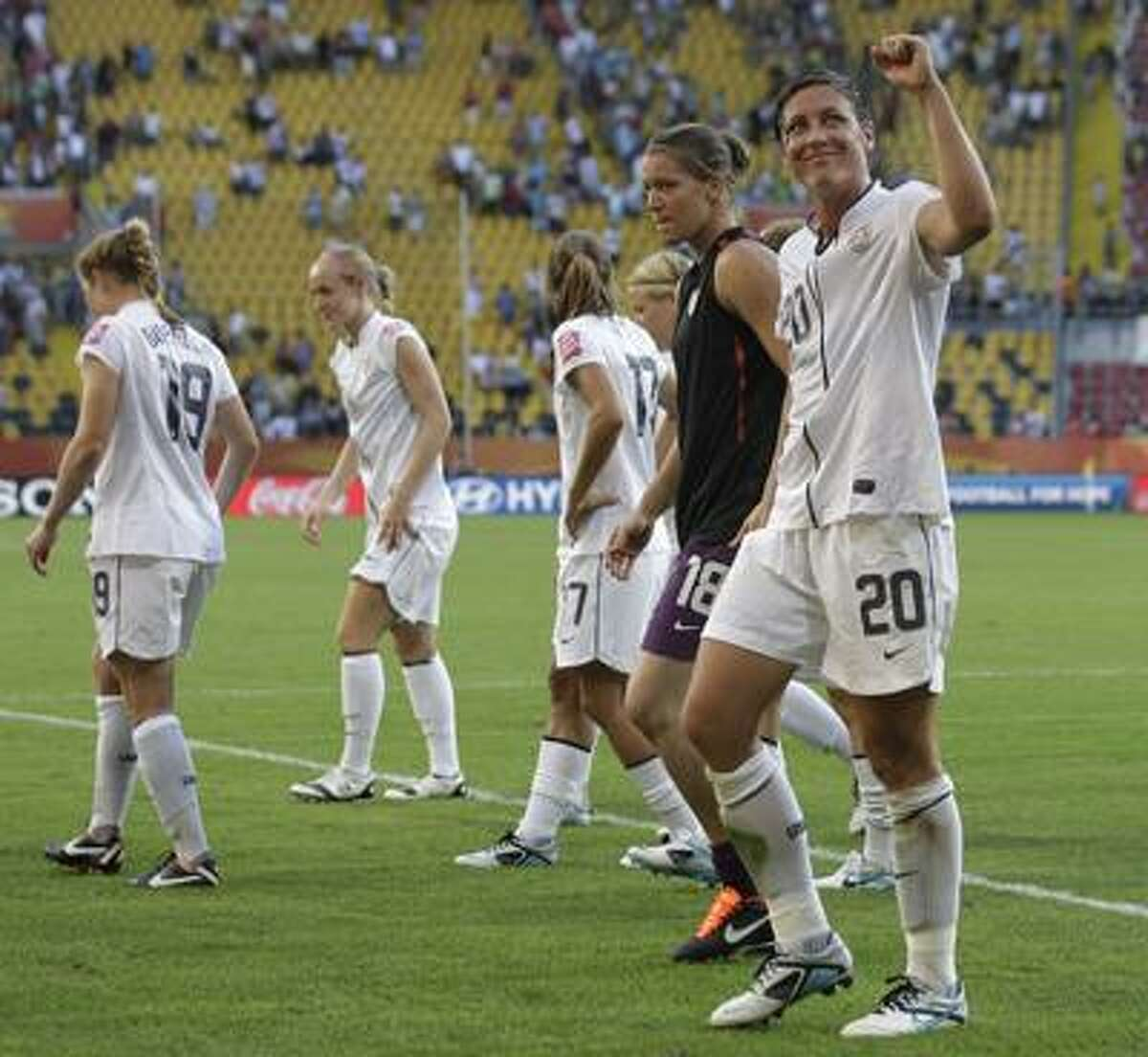 United States' Abby Wambach, right, reacts after the group C match between the United States and North Korea at the Women's Soccer World Cup in Dresden, Germany, Tuesday, June 28, 2011. The US team won 2-0. (AP Photo/Marcio Jose Sanchez)
