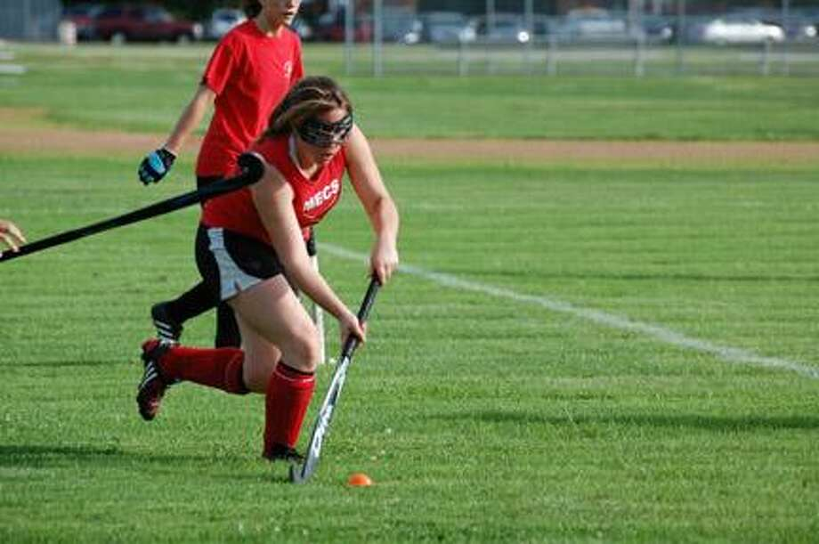 Submitted Photo by PENNY PATTERELLI Morrisville-Eaton's Kasey Holbert moves upfield during field hockey action in Canastota on June 27, 2011. The league is in its 22nd year, the 21st in Canastota.