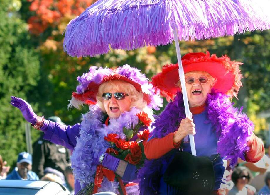 Contributed photo: A previous edition of the Columbus Day Parade brought out the ladies in the red hats. The inaugural Columbus Day Festival in Wooster Square will have pony rides, a petting zoo, Jilli the poker-playing pooch and lots of good food.