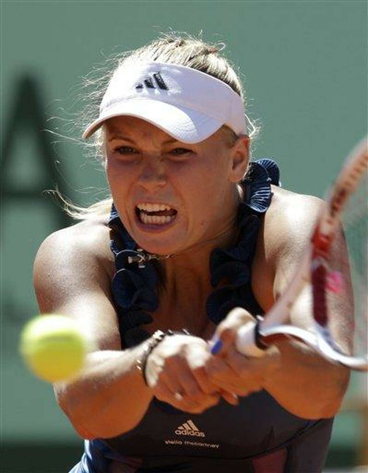 In this May 25, 2011 file photo, Denmark's Caroline Wozniacki returns the ball to Canada's Aleksandra Wozniak during their second round match of the French Open tennis tournament, at the Roland Garros stadium in Paris. (AP Photo/Lionel Cironneau, File)