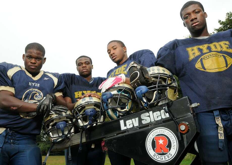 Hyde Academy's football captains left to right: Marcus Rogers, Devante Sealy, Akeem Berry, and Kahlil Morant photographed behind their old school in Hamden.  Mara Lavitt/New Haven Register10/3/12