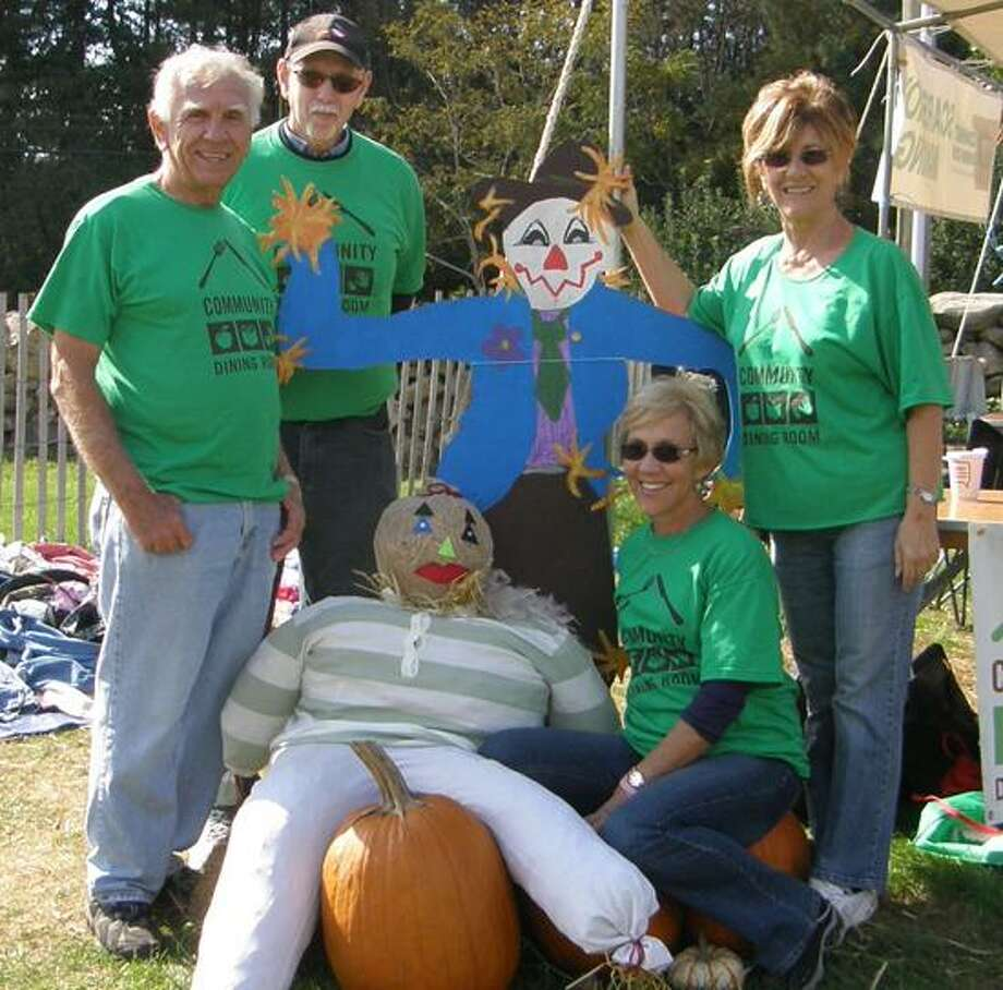 Community Dining Room photo: Century 21 AllPoints Realty agents Dick Lorenzo, Phil Brown, Nancy Orlando and Jayne Nunziante show off their scarecrow at last year's event.