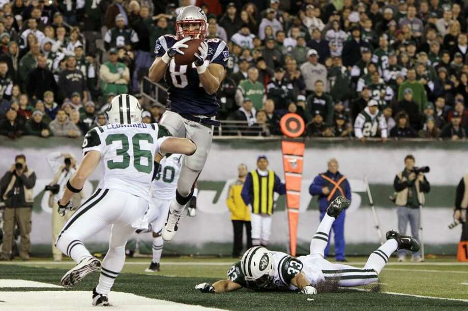 New England Patriots' Rob Gronkowski (87) catches a pass for a touchdown in front of New York Jets' Jim Leonhard (36) during the second quarter of an NFL football game Sunday, Nov. 13, 2011 in East Rutherford, N.J. (AP Photo/Kathy Willens) Photo: AP / AP2011
