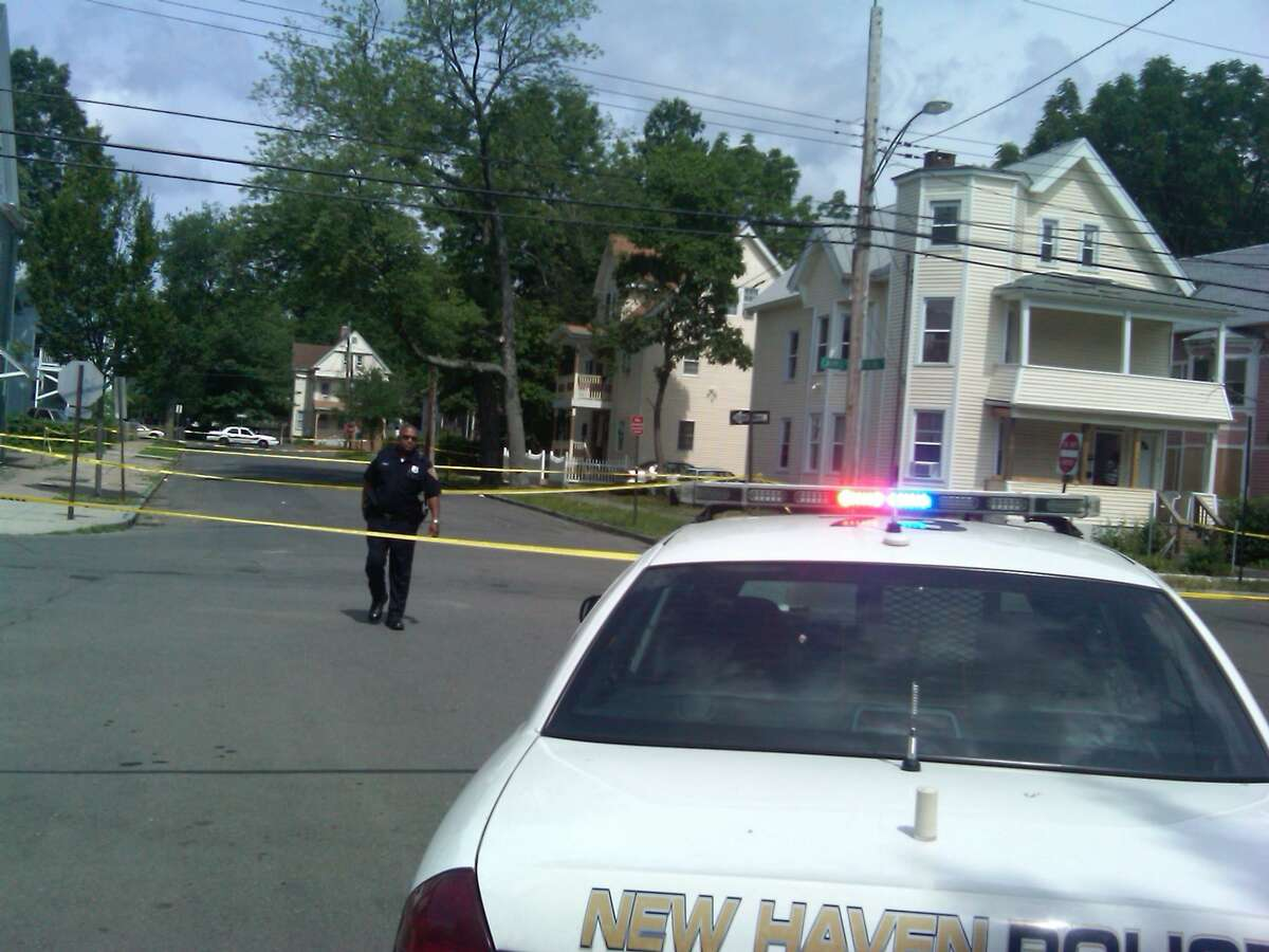 Police guard the shooting scene at Carmel and Percival streets. William Kaempffer/Register