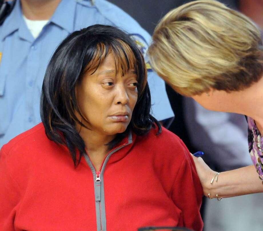 Rita Renee Johnson arraigned for murder at Meriden Superior Court. At right is her attorney Christine Janis. Mara Lavitt/New Haven Register10/2/12