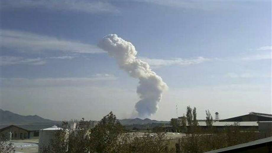 In this image taken from amateur video smokes rises from an accidental explosion at a Revolutionary Guard ammunition depot outside Bidganeh village,west of Tehran  which killed at least 15 people on Saturday Nov. 12, 2001, officials said.  The explosions occurred when military personnel were transporting munitions at a base, said Guard spokesman Ramazan Sharif. The base is located outside Bidganeh village, 25 miles (40 kilometers) southwest of the capital. (AP Photo)  TV OUT Photo: AP