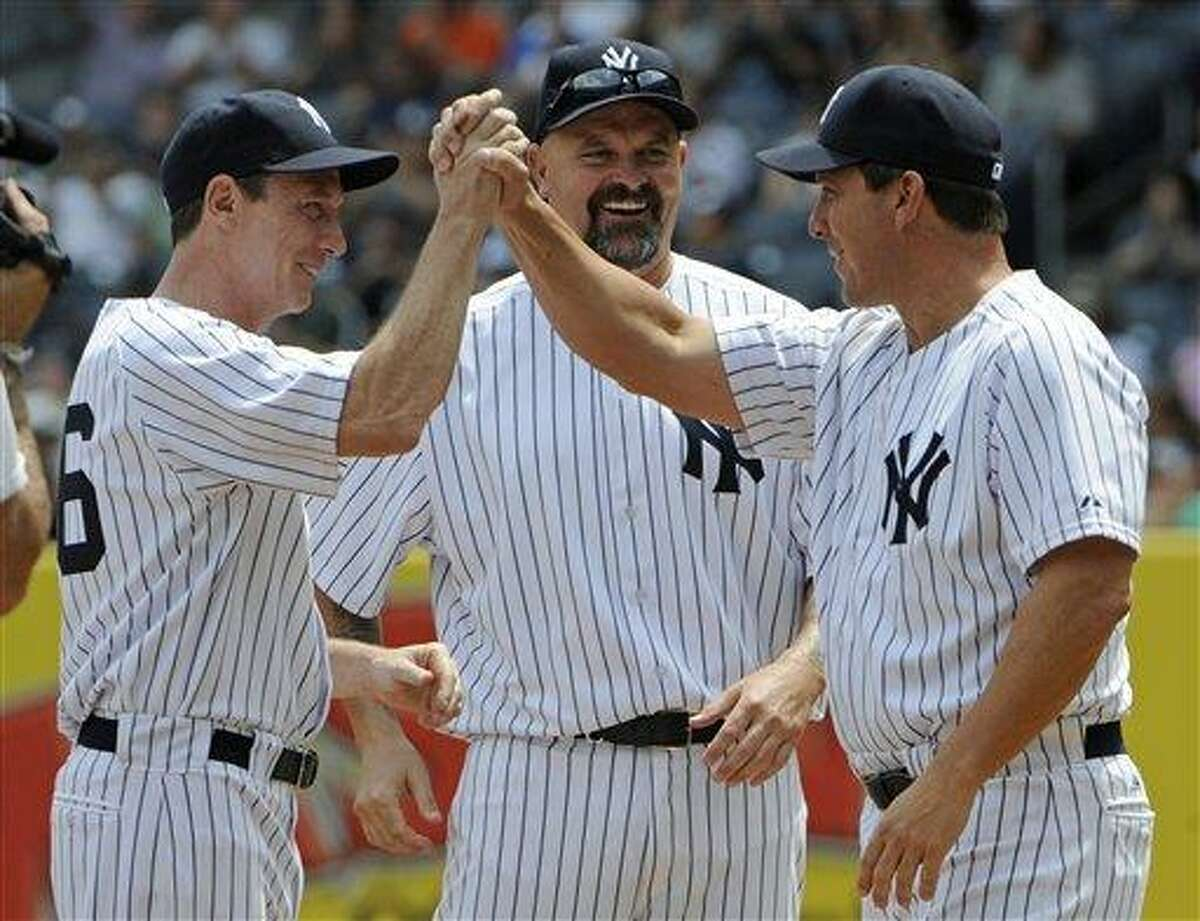 Former New York Yankees' David Cone, left, David Wells and Tino Martinez, right, reacts during Old Timers' Day ceremonies on Sunday, June 26, 2011, at Yankee Stadium in New York. (AP Photo/Bill Kostroun)