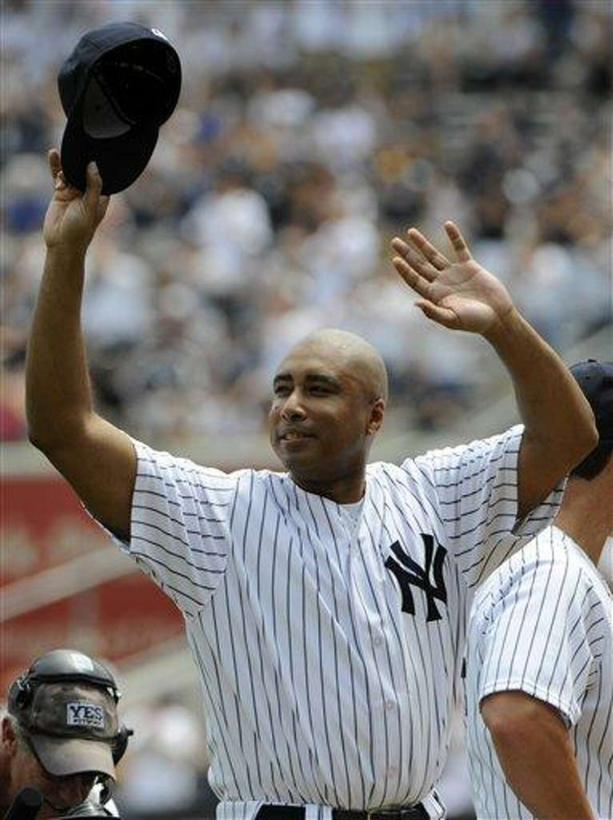 Former New York Yankees center fielder Bernie Williams reacts to applause during Old Timers' Day ceremonies on Sunday, June 26, 2011, at Yankee Stadium in New York. (AP Photo/Bill Kostroun)