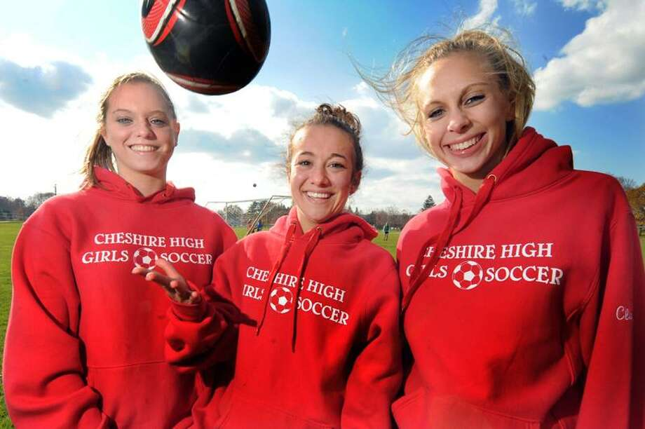 Sarah Domachine, Nikki Iadarola and Elena Manke captians of the Cheshire girls soccer team -team of the week. vm Williams 11.11.11