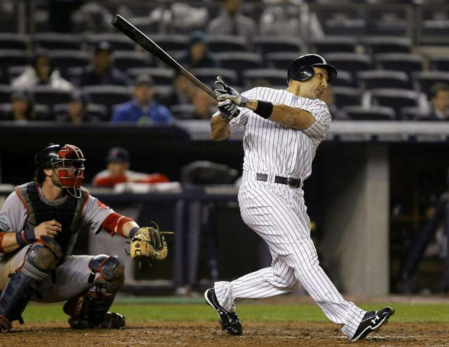 New York Yankees' Raul Ibanez hits a ninth-inning, two-run home run against the Boston Red Sox during their baseball game at Yankee Stadium in New York, Tuesday, Oct. 2, 2012. (AP Photo/Kathy Willens) Photo: AP / AP2012