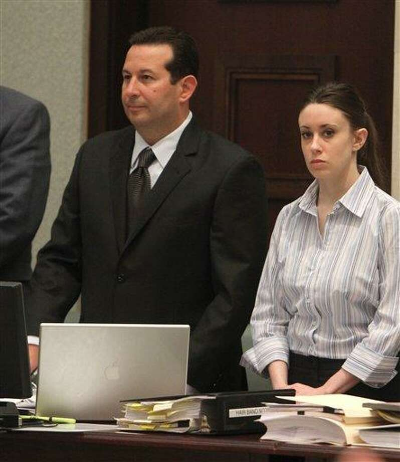 Attorney Jose Baez and his client Casey Anthony stand as the jury enters to courtroom for Anthony's trial at the Orange County Courthouse on Saturday, June 4, 2011 in Orlando, Fla. Anthony, 25, is charged with murder in the 2008 death of her daughter Caylee. If convicted, she could be sentenced to death. (AP Photo/Red Huber, Pool) Photo: AP / Orlando Sentinel, Pool