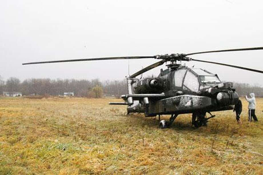 "Photo by MATT POWERS A military helicopter named ""Rainmaker"" lands in a Lenox field off Route 31 Friday, Nov. 11, 2011."