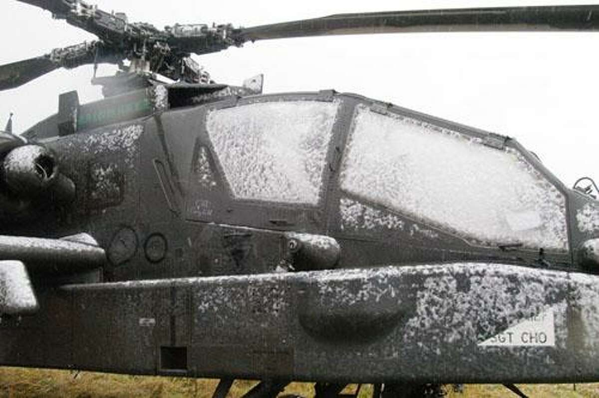 """Photo by MATT POWERS A military helicopter named """"Rainmaker"""" lands in a Lenox field off Route 31 Friday, Nov. 11, 2011."""