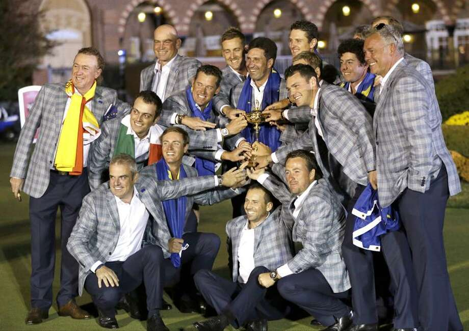 The European team posses with the trophy after winning the Ryder Cup PGA golf tournament Sunday, Sept. 30, 2012, at the Medinah Country Club in Medinah, Ill. (AP Photo/David J. Phillip) Photo: AP / AP2012