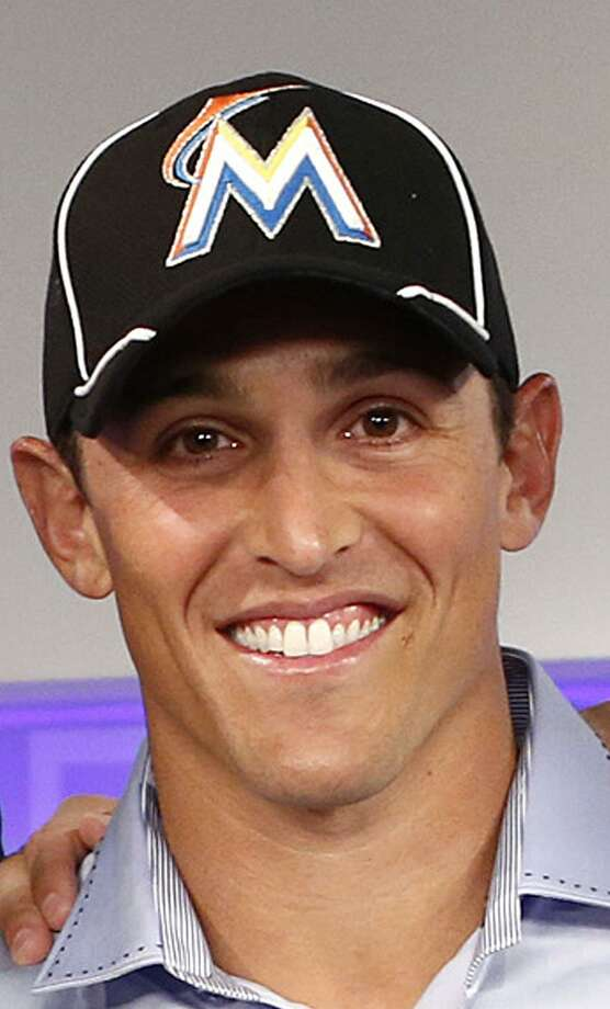 Guilford's Adam Greenberg was beaned by the first and only pitch he ever faced in the majors on July 9, 2005 while with the Chicago Cubs. The Marlins -- the team he was facing that fateful day -- have signed him to a one-day contract and he'll play tonight against R.A. Dickey and the Mets at Marlins Ballpark. (AP Photo/NBC NewsWire, Peter Kramer) Photo: AP / NBCUniversal Media2012