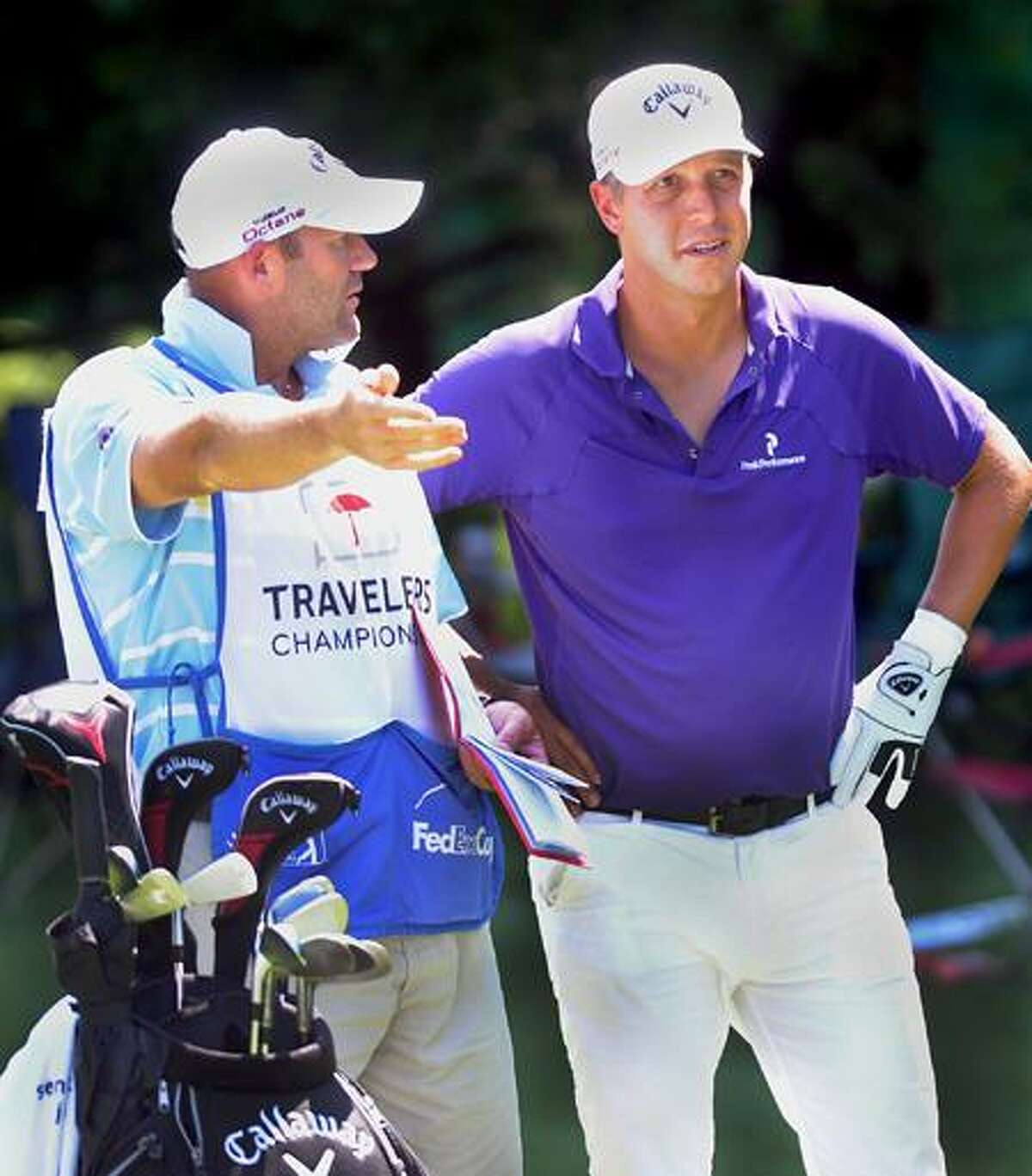 Fredrik Jacobson confers with his caddy during the Travelers Championship on Saturday. (Melanie Stengel/Register)