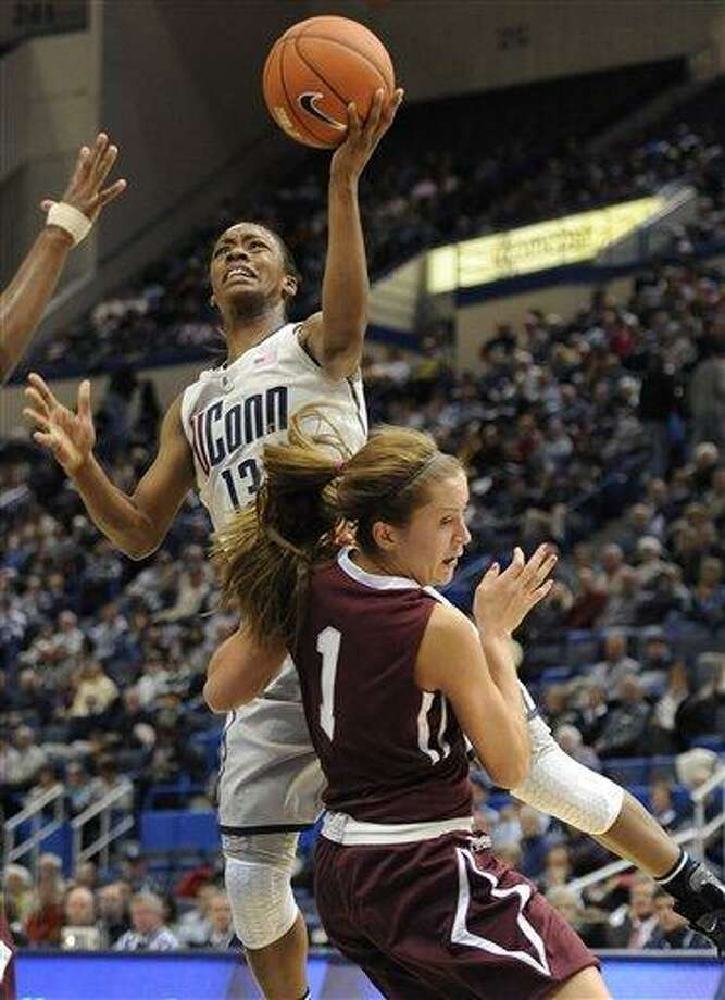 Connecticut's Brianna Banks, top is fouled as she goes up for a basket by Colgate's Lauryn Kobiela (1) during the first half of a NCAA college basketball game in Hartford, Conn., Wednesday, Nov. 28, 2012. (AP Photo/Jessica Hill) Photo: AP / FR125654 AP