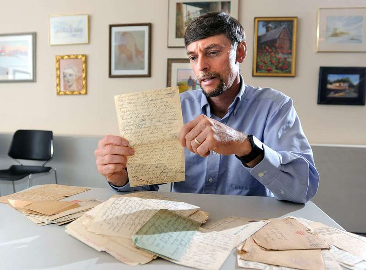 Guilford Parks and Recreation Director Rick Maynard looks at some of the letters from his great-uncle, Paul H. Maynard, telling of his experiences in the trenches of France during WWI. Peter Casolino/Register