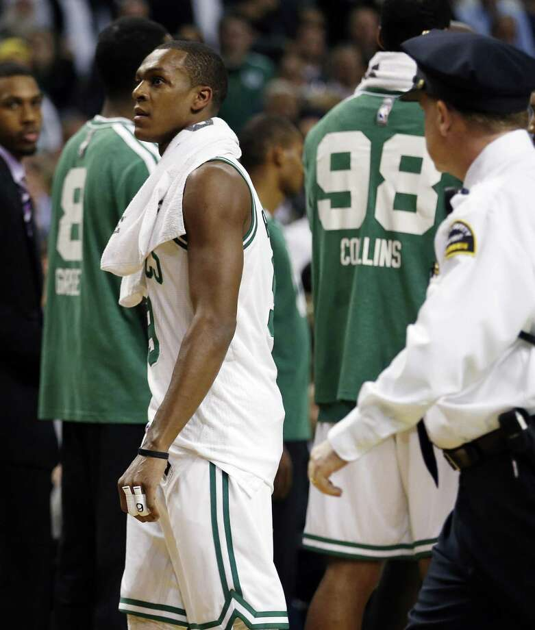 Boston Celtics' Rajon Rondo, center, walks off the court after being ejected in the second quarter of an NBA basketball game against the Brooklyn Nets in Boston, Wednesday, Nov. 28, 2012. (AP Photo/Michael Dwyer) Photo: ASSOCIATED PRESS / AP2012