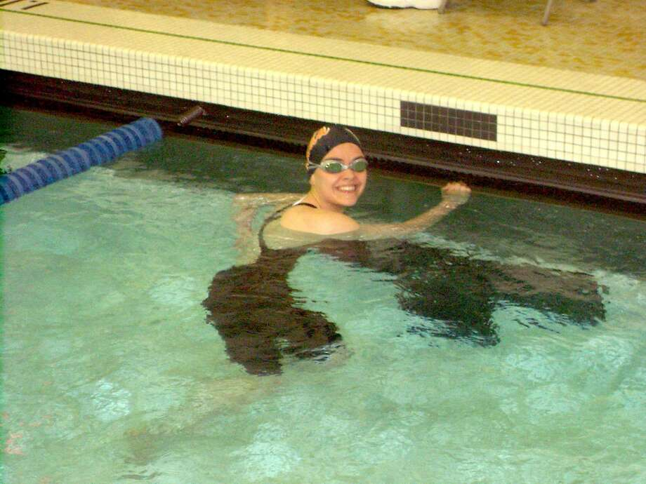 Submitted Photo Oneida's Chelsey Simon takes a break from swimming to smile for a photo. The independent swimmer picked up a Section III, Class B championship in the 200 freestyle.