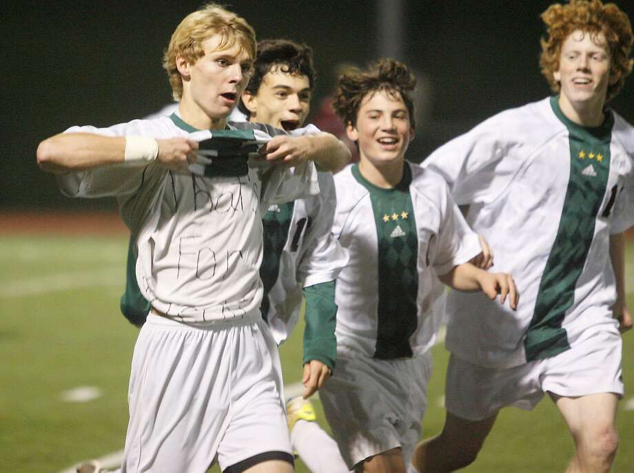 Dispatch Staff Photo by JOHN HAEGER (Twitter.com/oneidaphoto)  Hamilton's Sam Owens, far left, reveals an undershirt that says 'That's for Knecht' after scoring the first goal against Old Forge Tuesday. The Emerald Knights play in the Class D state quarterfinal Friday, November 11, 2011 at Morrisville State.