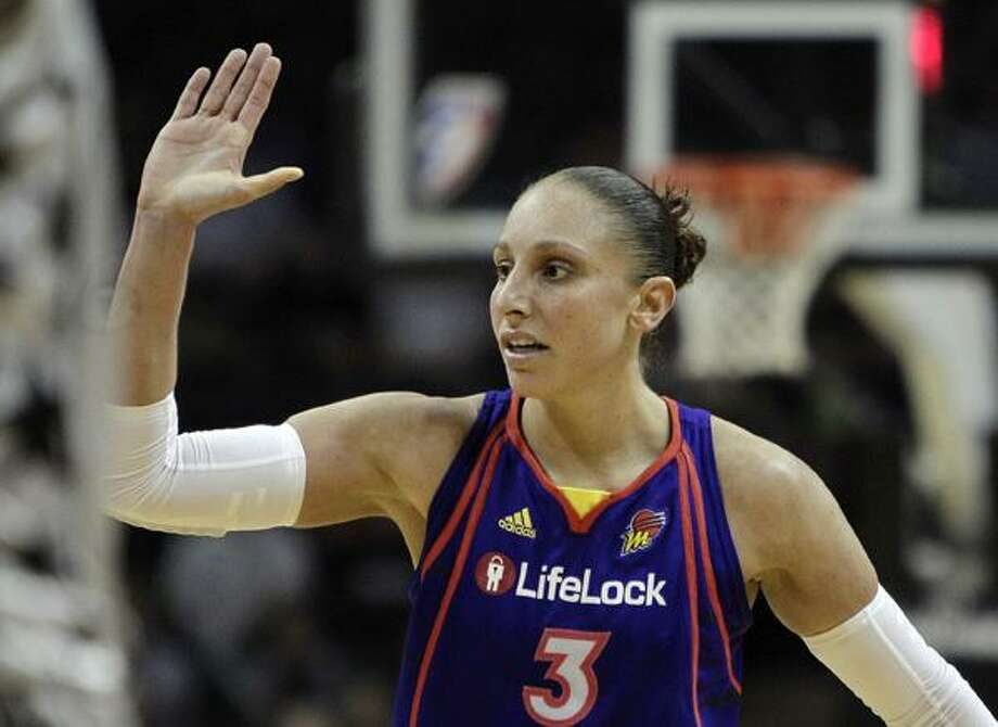 In this  Aug. 28, 2010 file photo, Phoenix Mercury's Diana Taurasi celebrates with teammates during the fourth quarter of a Western Conference semifinal WNBA basketball game against the San Antonio Silver Stars, in San Antonio. The Turkish basketball federation says it has lifted a provisional doping suspension on American player Diana Taurasi after a lab retracted a report that she tested positive for performance-enhancing substances. (AP Photo/Eric Gay, File)