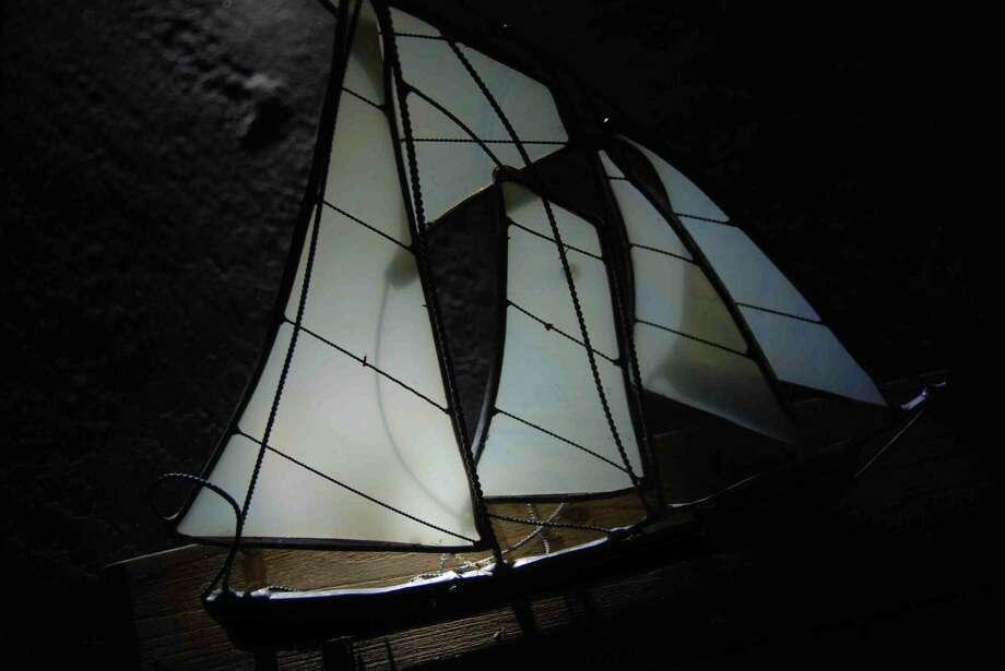 Knickknack ship sails through Sandy turmoil to safety of Milford beach.