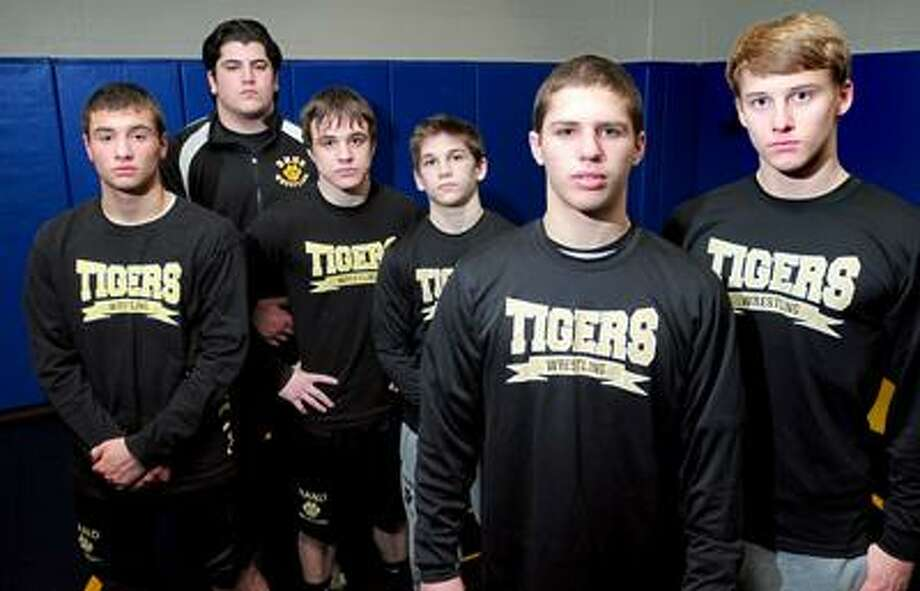 Hand wrestlers (left to right) Jake Savoca, Joe Demichele, Tucker MacGregor and Will Crisco are photographed with team captains Eddie Carroll and Welles Sakmar before practice on 2/16/2011.Photo by Arnold Gold/New Haven Register     AG0403A