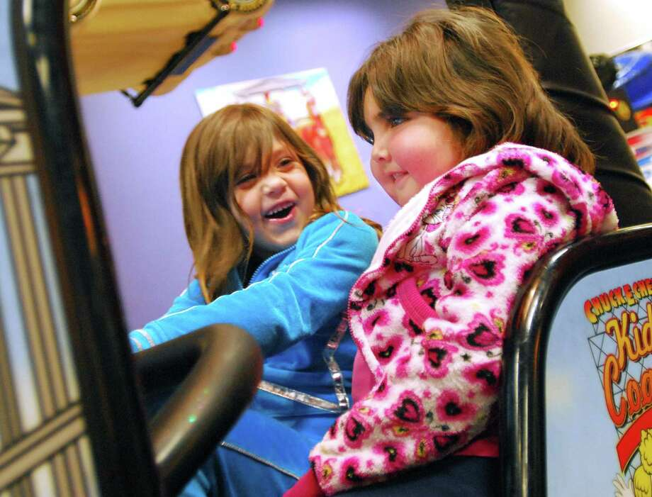 In this file photo, Zoe Anyan, 7, right, plays with family friend Madison Roman at Chuck E. Cheese's in Orange. Zoe, who had brain cancer, died this week.  Photo by Brad Horrigan/New Haven Register
