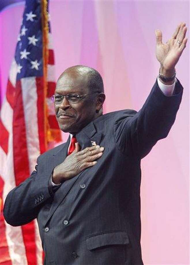 Republican presidential candidate Herman Cain gestures as he walks toward the podium to speak at the Defending the American Dream Summit, Friday, Nov. 4, 2011, in Washington. (AP Photo/Haraz N. Ghanbari) Photo: AP / Copyright 2011 The Associated Press. All rights reserved. This material may not be published, broadcast, rewritten or redistributed.