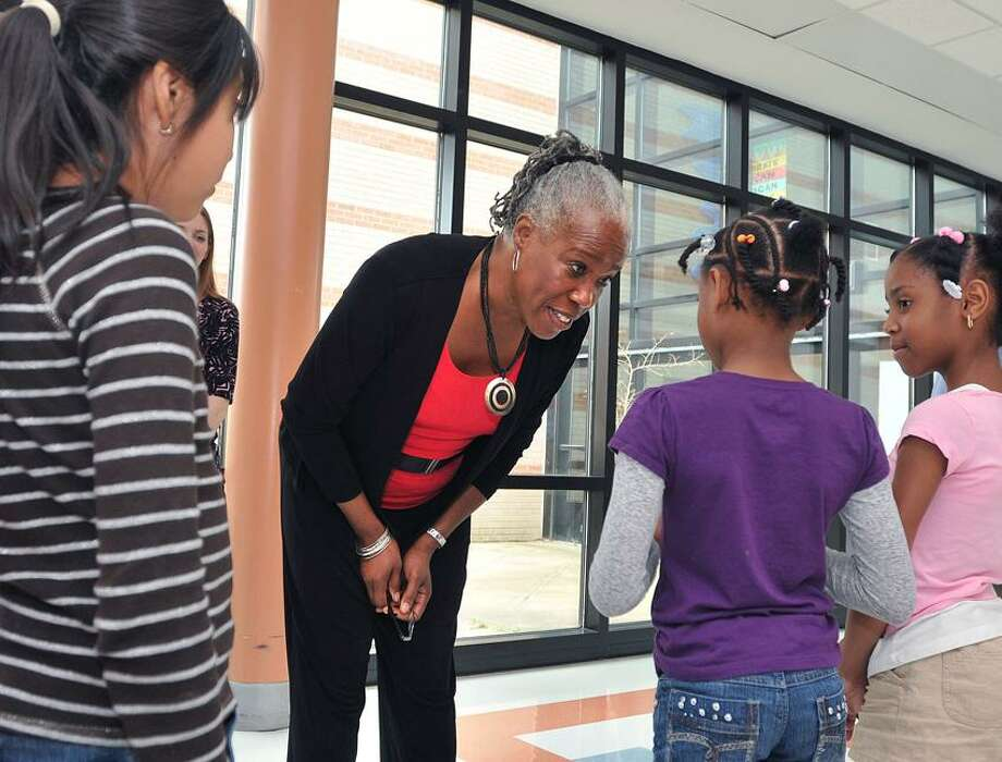 USDA Administrator for food and nutrition, Audrey Rowe, chats with children at Wexler School about their lunch choices as she visited the school to talk about the summer food service program.  Peter Casolino/New Haven Register