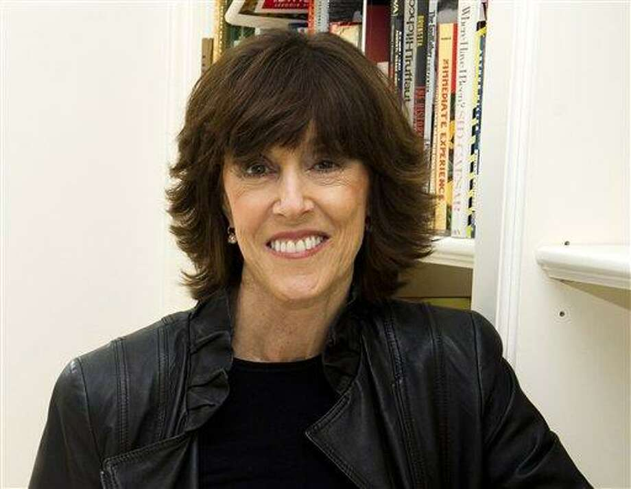 FILE - This Nov. 3, 2010 file photo shows author, screenwriter and director Nora Ephron at her home in New York.  Oscar-nominated filmmaker and author Nora Ephron is very ill, according to a representative for her publisher. Nicholas Latimer of Alfred A. Knopf confirmed her condition on Tuesday, June 26, 2012, hours after celebrity columnist and friend Liz Smith published what appeared to be a memorial for the writer. Smith told The Associated Press that she had spoken to Ephron's son Tuesday morning and was told that Ephron was dying. She said when she heard that funeral plans had already been arranged, she published the column on the website Women on the Web. Latimer did not provide any additional information on Ephron's condition. (AP Photo/Charles Sykes, file) Photo: AP / AP2010