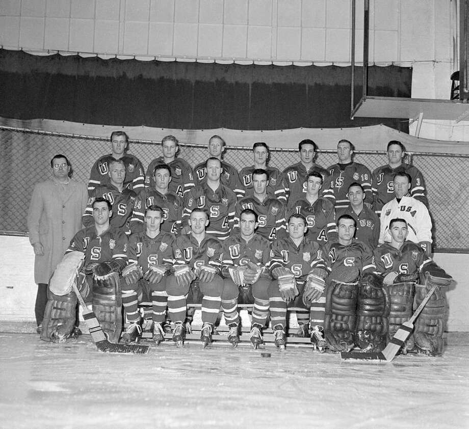 The United States Olympic Ice Hockey Squad shown on the ice rink at the United States Military Academy at West Point, New York on Jan. 6, 1960. From left to right are (first row): Jack McCarten; Herb Brooks, Weldy Olson, Paul Johnson, Richard Meredith, Harry Batchelder, Larry Palmer; (second row) Jim Claypool, manager; Rod Paavola, Harry Berg, Bob McVey, Roger Christian, William Christian, Ben Bertini, trainer, Jack Riley, coach; (third row) Tom Williams, Bob Owen, Dave Outerbridge, Bob Depuis; Gene Graziam; Larry Alm; Jakc Kirrane. (AP Photo/John Rooney) Photo: AP / AP1960