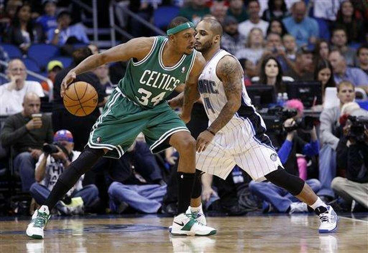 Boston Celtics small forward Paul Pierce (34) controls the ball against Orlando Magic point guard Jameer Nelson (14) during the first half of an NBA basketball game, Sunday, Nov. 25, 2012, in Orlando, Fla. (AP Photo/Scott Iskowitz)