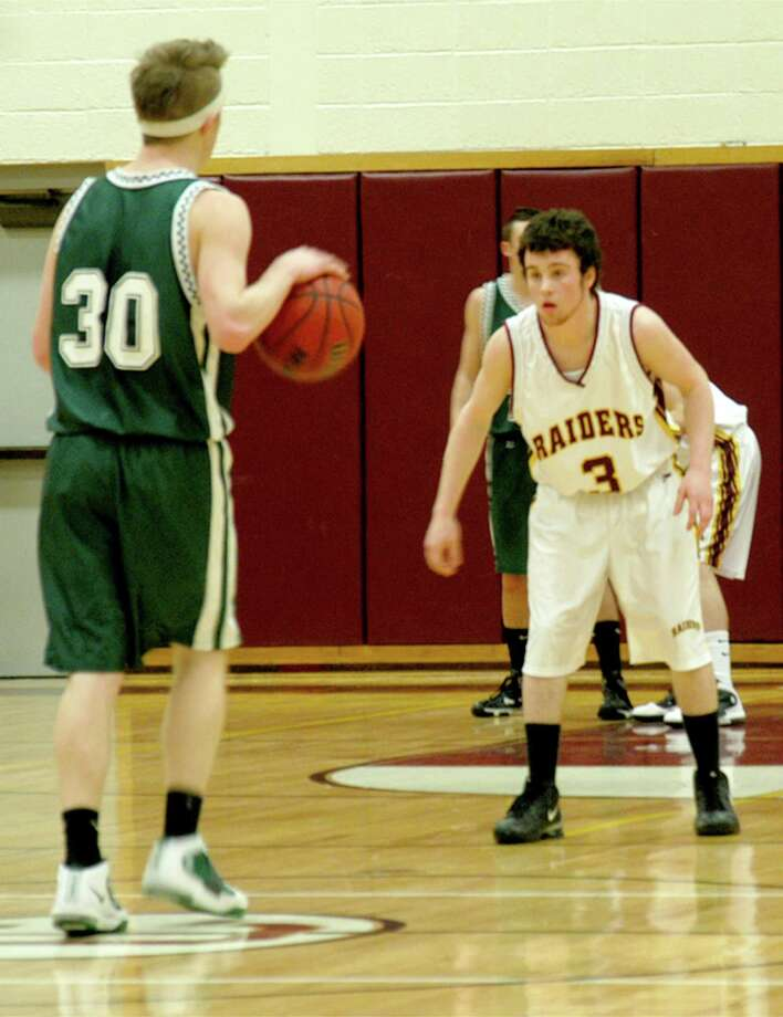 Dispatch Staff Photo by DAVID M. JOHNSON Adirondack's Matt Sprowell (30) brings the ball up as Canastota's James Mason (3) defends in the first half of their game on Monday Feb. 14, 2011 in Canastota. The Wildcats won 62-45.