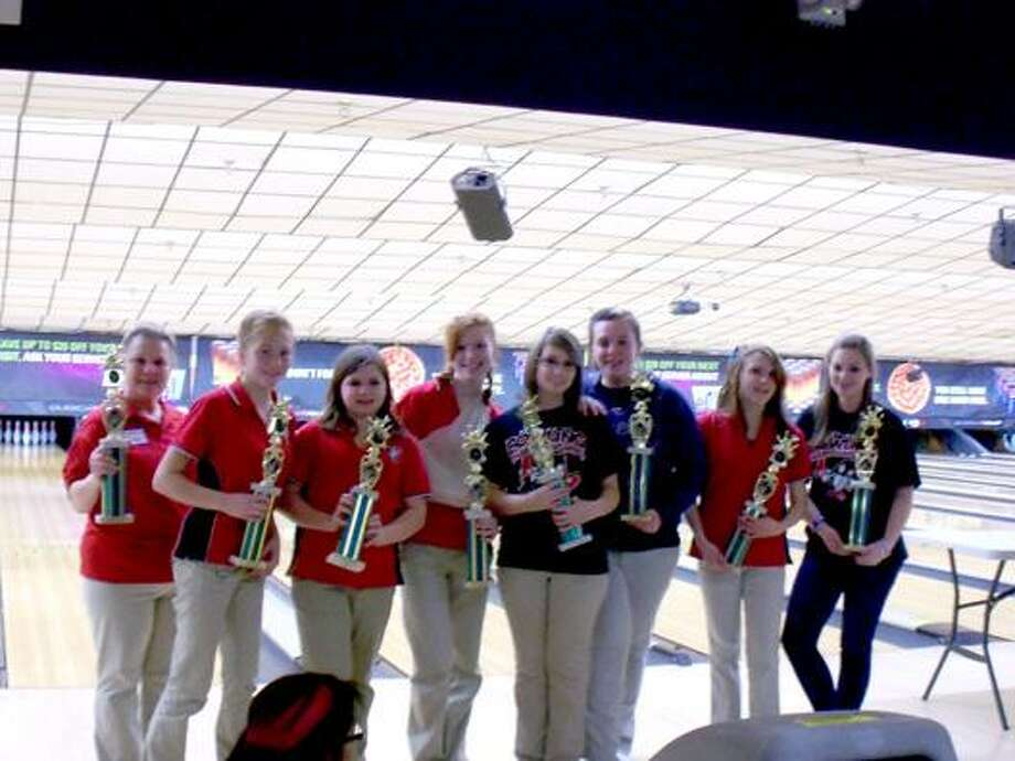 Submitted Photo VVS' girls bowling Coach Diana Nimmo, far left, and the rest of the team pose with their Section III Class B championship trophies after winning at Pin-O-Rama in Utica Sunday afternoon. Camden finished second.