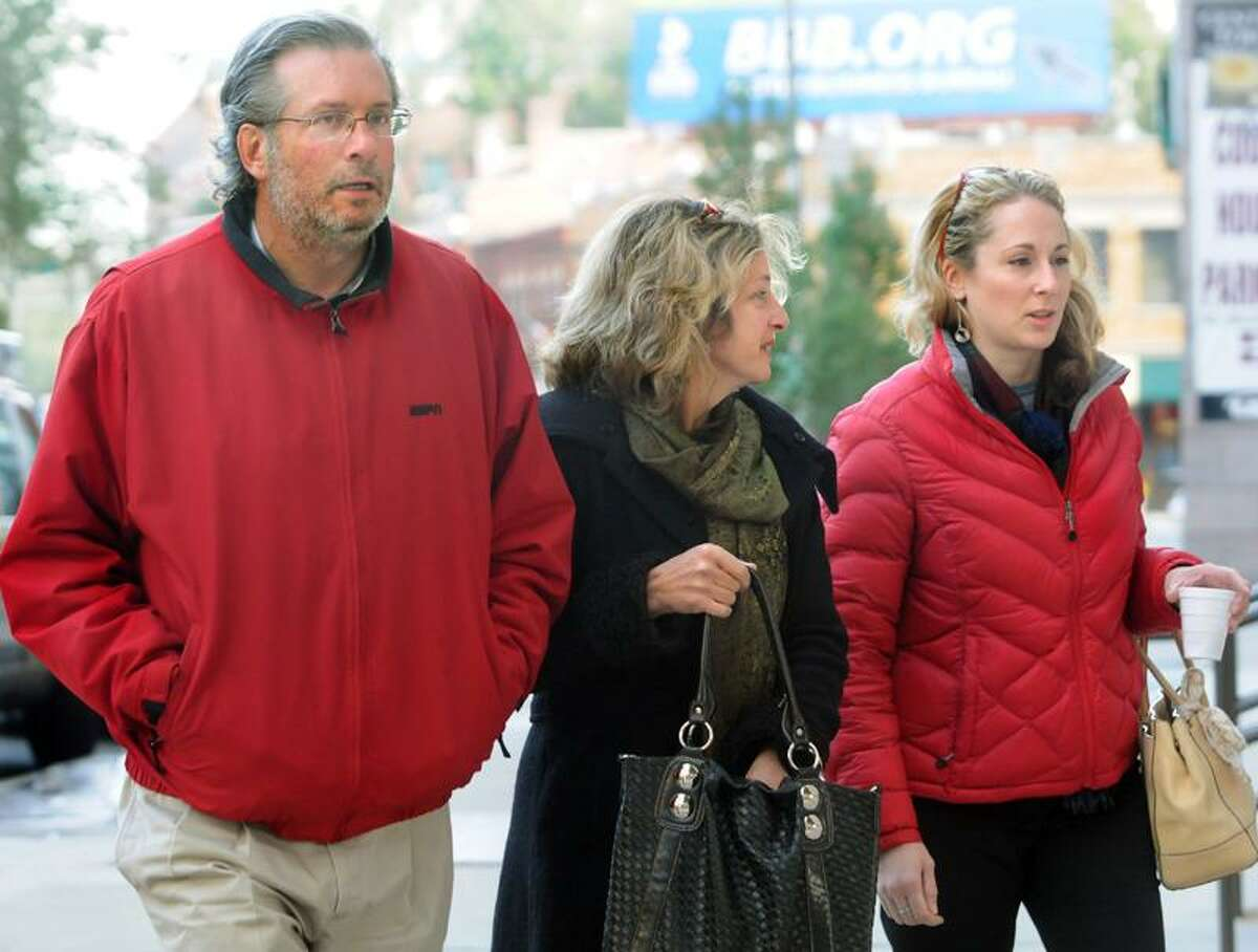 From left, Dr. William Petit Jr., his sister, Johanna Chapman, and Petit's girlfriend arrive at court Tuesday in New Haven. Melanie Stengel/Register