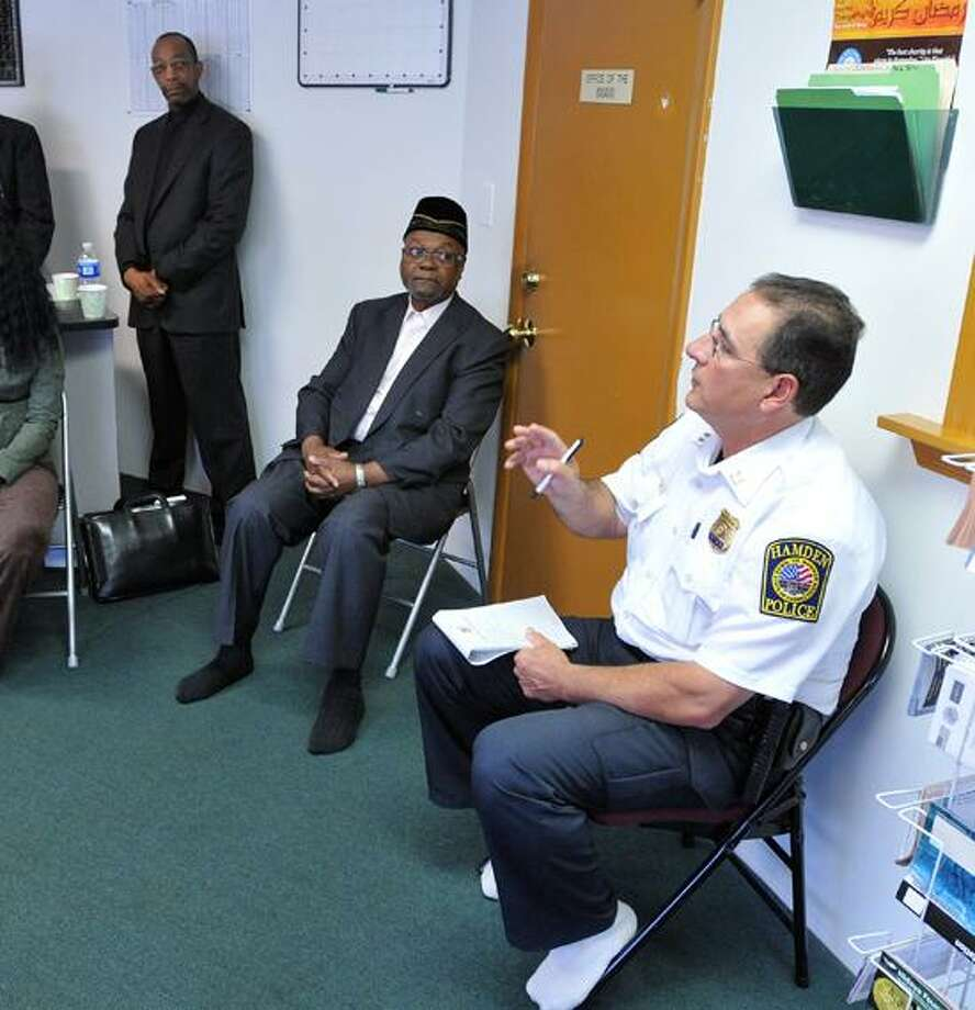 Hamden police Cpt. Ronald Smith talks to residents about violence in the Newhall area of Hamden at the Abdul-Majid Karim Hasan Islamic Center. Peter Casolino/New Haven Register