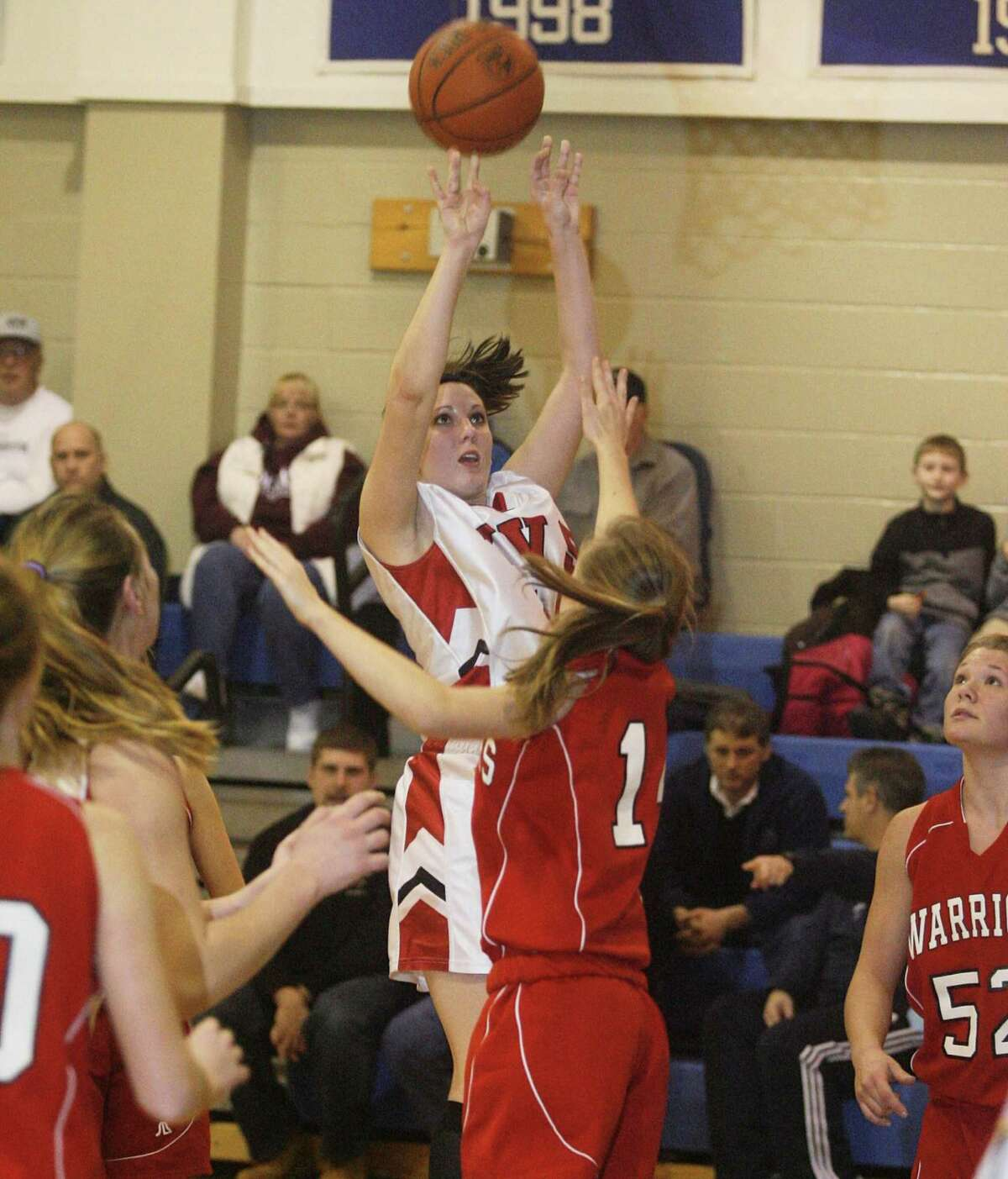 Dispatch Staff Photo by JOHN HAEGER twitter.com/oneidaphtot VVS Leanne Doolen (44) puts up a shot for two over MECS Jessica Murray (14) in the first half of the Madison Holiday Tournament on Friday Dec. 30, 2011 in Madison.