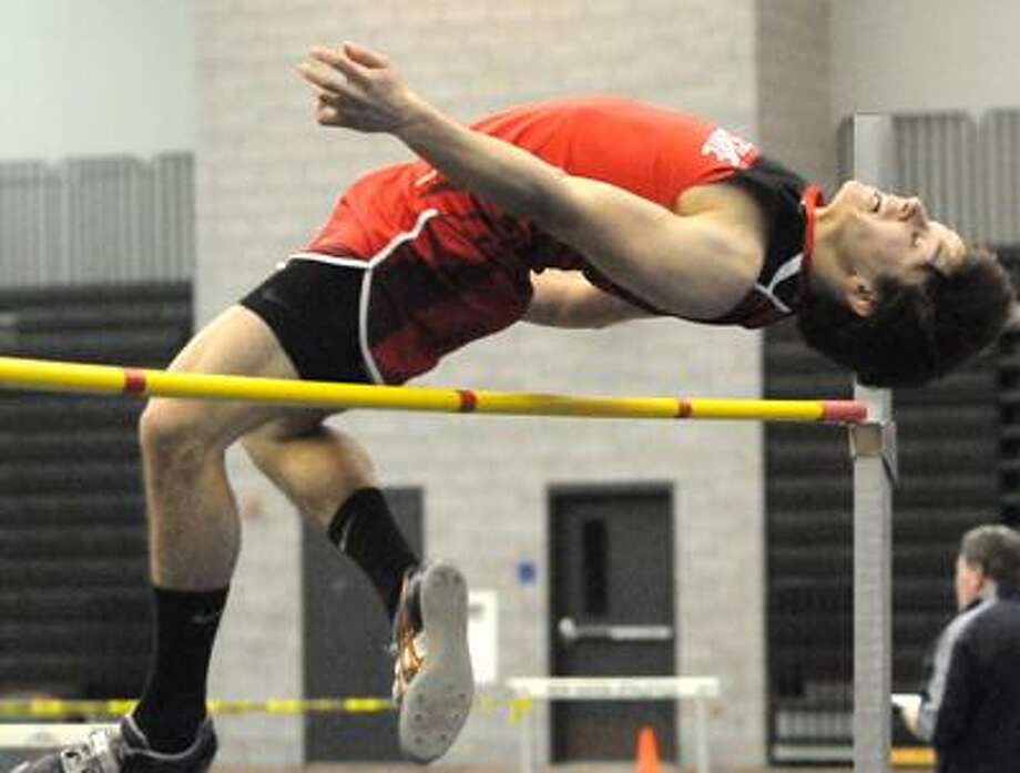 Jake Scinto of Cheshire High School clears the high jump for the Class LL State Championship. Photo by Peter Hvizdak / New Haven Register February 12, 2011      ph2252               #8355   Connecticut