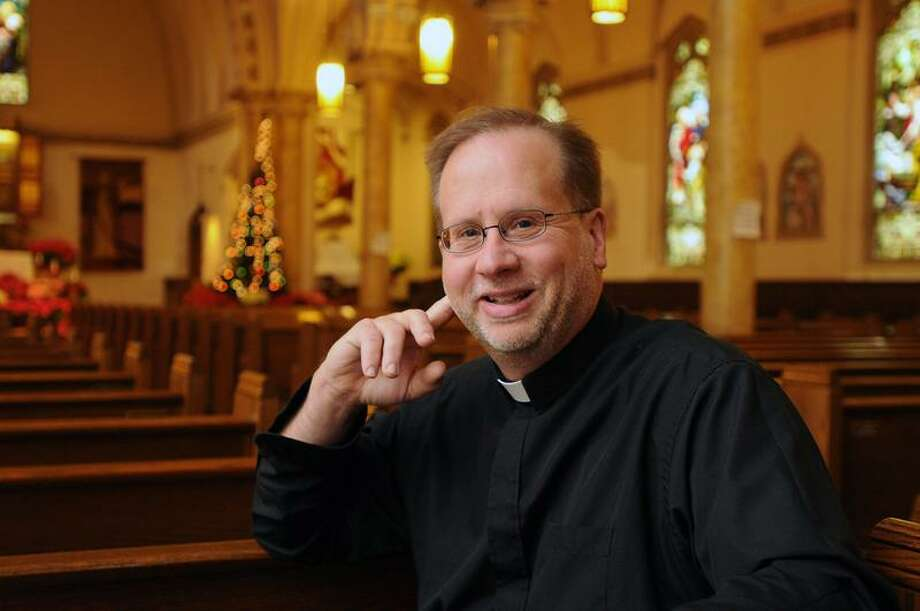 The Rev. James Manship of St. Rose of Lima church in Fair Haven is the New Haven Register's Person of the Year for 2011. (Peter Casolino/Register)