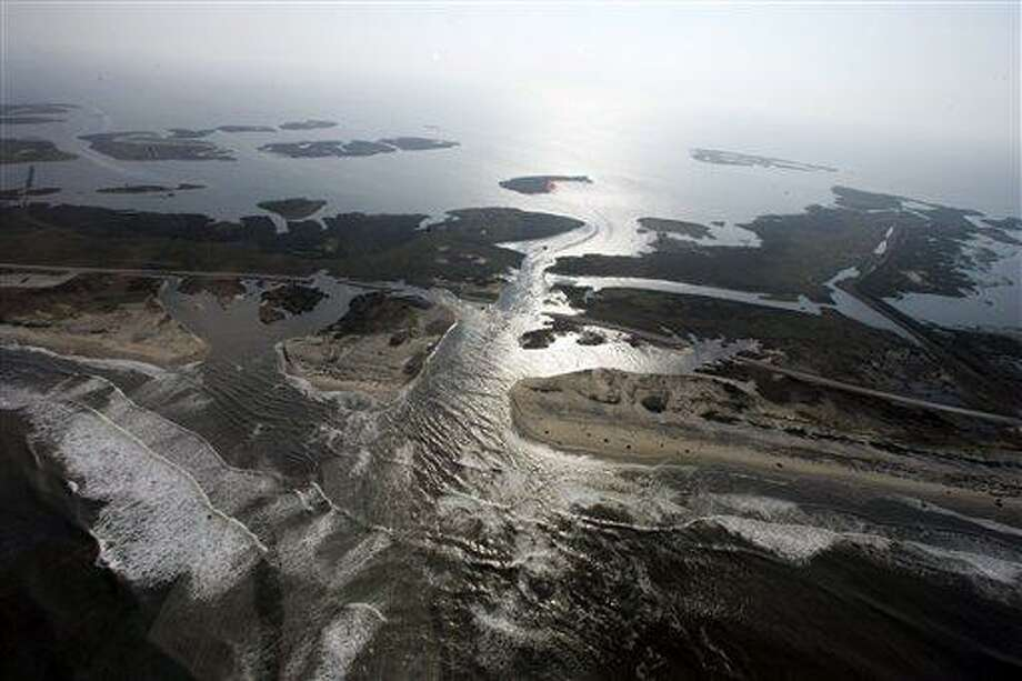 """This 2011 file photo shows a flooded road on Hatteras Island, N.C., after Hurricane Irene swept through the area the previous day cutting the roadway in five locations. From Cape Hatteras, N.C., to just north of Boston, sea levels are rising much faster than they are around the globe, putting one of the world's most costly coasts in danger of flooding, according to a new study published Sunday in the journal Nature Climate Change. By the year 2100, scientists and computer models estimate that sea levels globally could rise as much as 3.3 feet. The accelerated rate along the East Coast could add about another 8 to 11 inches, Asbury Sallenger Jr., an oceanographer for the USGS said. """"Where that kind of thing becomes important is during a storm,"""" Sallenger said. That's when it can damage buildings and erode coastlines. Associated Press Photo: AP / Copyright 2011 The Associated Press. All rights reserved. This material may not be published, broadcast, rewritten or redistributed."""
